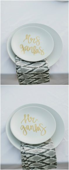 Sweetheart table placesetting, white Mr. & Mrs. plates, names painted in gold, patterned grey napkins // Wild Whim Photography