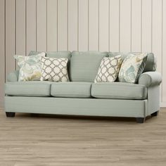 Brimming with understated style, this seafoam-hued sofa refreshes your favorite seating group in sophisticated style. Add it to the den to complement a bold boho arrangement or use it to level out a cozy cottage look in the living room. Its 4 throw pillows add a pop of pattern to your space while its solid color blends effortlessly into any palette. Pair this piece with a lightly weathered coffee table for a cohesive beach-chic arrangement, then round out the look with a jute rug to define…
