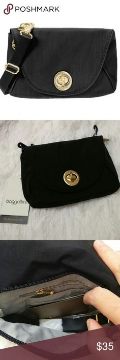 Baggallini seville mini black The size of this bag is approximately of a open hand. Details are in gold. Baggallini Bags Crossbody Bags