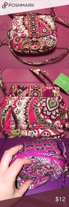 "Vera Bradley little hip bag very berry paisley Very small bag can be worn as a crossbody or on a belt. Magnetic snap closure with slip in pocket. Zippered compartment with 2 credit card slots.  5 1/2 W X 5"" H Vera Bradley Bags Crossbody Bags"