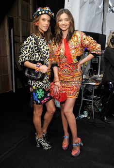 Alessandra Ambrosio (L) and Miranda Kerr pose backstage at the Moschino Resort 2017 on June 10, 2016 in Los Angeles