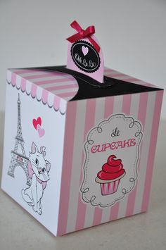 "Ooh La La! This chic ""Le Cupcake"" favor box featuring the Eiffel Tower, Marie the Aristocat and Paris travel stamps, makes a perfect favor idea for your Paris Party. Très chic!"