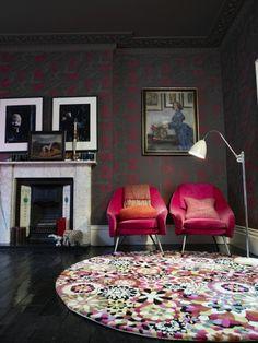 dark walls, pop chairs, funky rug