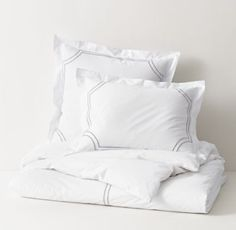 RH TEEN's Italian Framed Satin Stitch Duvet Cover:Cosmopolitan and comfy, our marquee bedding is impeccably crafted from the finest Egyptian cotton. A master Italian fabric house weaves the lush percale and tailors the collection with care, finishing each piece with picture-perfect satin stitching.