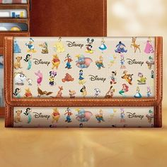 The Magic of Disney wallet by Bradford Exchange. I need this