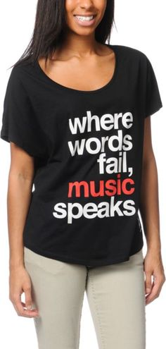 """Element Girls with the Zumiez Exclusive black Music tee shirt. Rock and mosh to your favorite bands in this over-sized top with a wide open neckline, short dolman sleeves, boyfriend fit and rounded hem. The custom JV """"Where Words Fail, Music Speaks"""" graphic and Element x Jac Vanek collaboration logo are on the front in full view."""