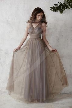 Jacquelin Bridals Canada - 22667 - Bridesmaids - Flowing with elegance, this semi A-line full tulle overlay gown is complete with a V-neck tank-style bodice and thick waistband accented with a sparkling brooch. Pictured in: Mocha/Platinum