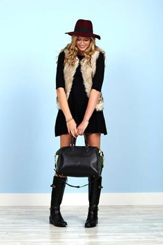 For any casual occasion, rock a knit dress, and layer on your faux fur vest. This low-key look pairs well with riding boots and a wool fedora.