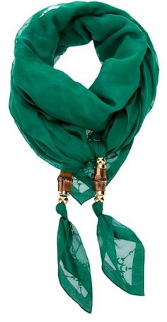 Gorgeous emerald color, but I want to figure out the bead/knot detail on the scarf ends. I usually wear scarves in place of necklaces, and the beads would be perfecto.