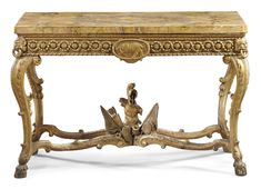 An Italian carved giltwood console table, Roman, in the manner of Antonio Landucci Transitional, circa 1770. 90cm. high, 138cm. wide; 2ft. 11½in., 4ft. 6¼in.