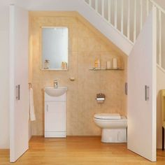 This Small Bathroom Design Under Stairs, Under Stairs Bathroom Planning, Read Article Understairs Toilet, Understairs Ideas, Bathroom Under Stairs, Basement Bathroom, Toilet Under Stairs, Bathroom Layout, Bathroom Storage, White Bathroom Furniture, Basement Furniture