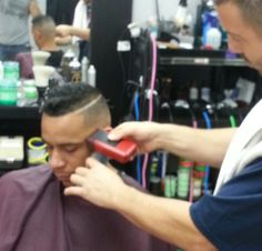 Me finishing up a skin fade with a razor part.  One of my early bird customers!
