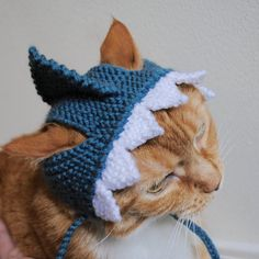 Include your cat in your Halloween festivities with this adorable shark costume! This cat hat / cat costume was hand knit with acrylic yarns and fits an average size adult cat. Great for a gift or as a treat for your own kitten!  All orders are shipped first class via USPS. Please see shop announcements section for up-to-date production and shipping times. Follow me on Twitter! www.twitter.com/bitch_knits Like me on Facebook! http://www.facebook.com/b1tchknits