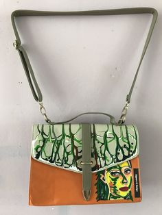 This handbag is 23 cm heigh and 32 cm wide.Handpainted