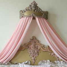 Little girls bed looking like something from a magical dream.