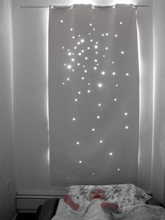 This one is for sale, but I'm sure you could make something similar with blackout fabric or a thick shower curtain. Cut out star shapes. Hang in a window that a lot of light comes through or really anywhere you want a little star shimmer