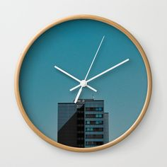 "Available in natural wood, black or white frames, our 10"" diameter unique Wall Clocks feature a high-impact plexiglass crystal face and a backside hook for easy hanging. Choose black or white hands to match your wall clock frame and art design choice. Clock sits 1.75"" deep and requires 1 AA battery (not included). #juledecule #wallclock #society6 #urban #architecture #minimalismus #blue #style"