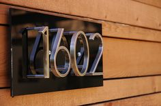 Black and chrome neutra house numbers