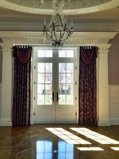 Living Room Drapery Install before furniture. Scott Carpenter Interiors