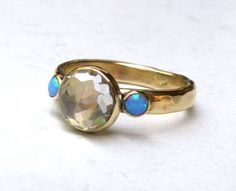 Handmade Engagement Ring Similar diamond ring wedding ring Blue Opals Gemstone ,statement, fine 14k gold ring MADE TO ORDER by OritNaar on Etsy https://www.etsy.com/listing/128753520/handmade-engagement-ring-similar-diamond