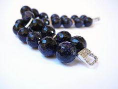 Dark blue gemstone beaded  two strands bracelet of blue goldstone  and sterling silver, finished with a magnetic clasp