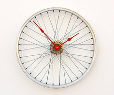^Recycled Bicycle Wheel Clock^  |  By ~pixelthis~  *This clock was created from a recycled aluminum bike wheel. The wheel mounts directly to the wall through the hub using a hollow wall anchor and gives the illusion that it is floating off the wall. The clock movement is a high torque German quartz movement and is attached to a set of rear cassette gears to conceal the movement. The clock runs on 1 AA battery.  Handmade in the USA*   |