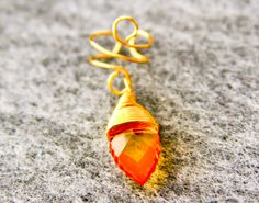 Golden Orange Ice Ear Cuff by BarbedLotusDesigns on Etsy, $10.00