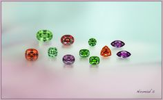 The Garnet family has an incredible diversity of colors and nuances. A part of it is pictured here,- Demantoid Garnet from Russia, Tsavorite and Mint Grossular Garnet from Tanzania and Kenya, Mandarin Garnet from Nigeria and Rhodolite from Mozambique.