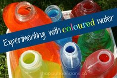 containers of coloured water for play