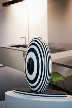 Sculpture in solid surface material. Wave Showroom. Winner 2011 National Staron Awards [Aust]. Design by Peter Carman Dakota Design