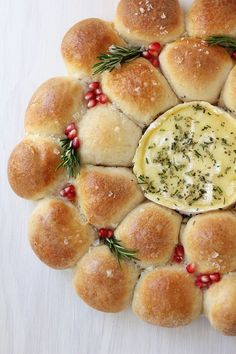 A festive pull-apart bread wreath with baked Camembert center makes a stunning holiday appetizer and centerpiece.