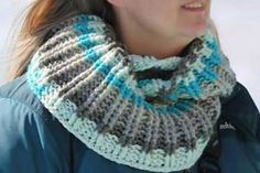 On my recent trip on a Crochet Cruise, I crocheted this simple cowl to wear on an excursion to the top of a glacier in Juneau, Alaska. This pattern uses only one Caron Cake. I made mine with the color Cake Pop. The colors really did resemble the stunning beauty of the magnificent glacier. The ribbed texture makes this cowl easy to wear as a long version or doubled up around your neck to keep you warm and cozy.