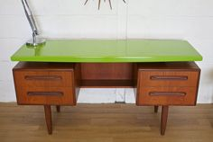 ITEM DESCRIPTION  G Plan Desk  WOW!! This is a unique one off professionally upcycled G Plan desk/dressing table - featuring a spray painted top in vibrant green and a high gloss finish.  Its in really good condition - please see condition notes for area of wear.  DIMENSIONS (approx)  Height = 70cm  Wide = 152.5cm  Deep = 46cm  CONDITION The condition of this item is in good solid condition.  It is mostly in very good condition - there is a issue with the veneer underneath the top on one…