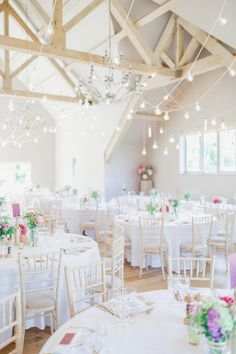 Barn Reception with Pink Flowers & Hanging Lights - White Stag Wedding Photography | Pastel Wedding at Hyde House, Cotswolds Country Barn | Naomi Neoh Bridal Gown | Alfred Sung Pink Bridesmaid Dresses | Ted Baker Suit
