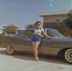 Woman and her car, 1960s.