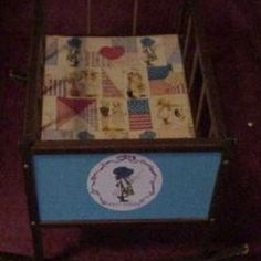 I had this Holly Hobbie baby doll bed.  Although what I really loved to do was play in the mud and climb trees.