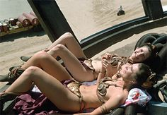 Carrie Fisher and her stunt double Tracey Eddon sunbathing while on a break from filming Return of the Jedi.
