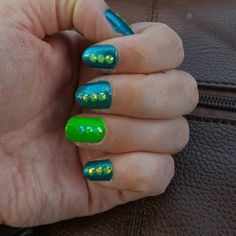 Two shades of green. Matching nail decorations