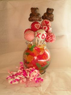 Luv U Beary Much Cake Pop bouquet by Cakes and Bakes in Strawn, TX.  Cake pops, including bears, are all cake, no frosting. These are candy coated and hand embellished. Like us on Facebook www.facebook.com/strawncakesandbakes.