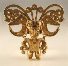 "Tairona Gold Pectoral of a Shaman - FJ.6205  Origin: Colombia  Circa: 600 AD to 1600 AD  Dimensions: 4.5"" (11.4cm) high x 5.25"" (13.3cm) wide  Catalogue: V23  Collection: Pre-Columbian  Medium: Gold"