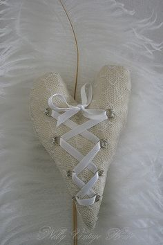 Fabric heart laced up - I can't decide if this makes me think of a corset or a ballet shoe, but it's very pretty  ********************************************  nelly vintage home - #fabric #heart #laced #tå√