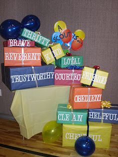 Just another cute idea for Blue and Gold Decorations.with Core Values. Just decorate some empty boxes. This would also be cute for a eagle scout court of honor.