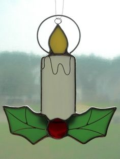 stained glass Holly and Candle suncatcher by Cinalou on Etsy, $22.00