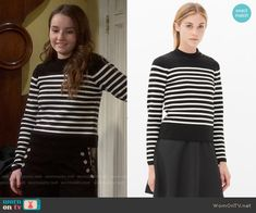 Eve's black and white striped sweater on Last Man Standing. Outfit Details: https://wornontv.net/56848/ #LastManStanding