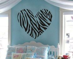 Lots of Zebra themed bedroom decor ideas for girls. Image shows a Removable Wall Decal Heart in a Zebra Print. #Zebrabedrooms