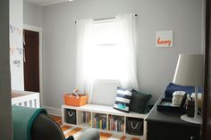 I love the colors in this nursery!  And the whale pillow. =)