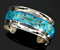 Sterling silver Candelaria turquoise rug pattern inlay bracelet by Jerry T Nelson, Navajo:
