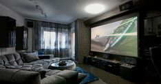 Home theaters Projectors vs. TVs: Which big screen should rule your home theater Home Theater Screens, Home Theater Setup, Best Home Theater, Home Theater Speakers, Home Theater Design, Home Theater Projectors, Home Theater Seating, Living Room Theaters, Small Home Theaters