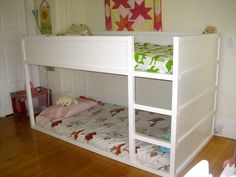 Ikea kids loft bed painted white. love how low to the floor the bottom bed is. hmmm....