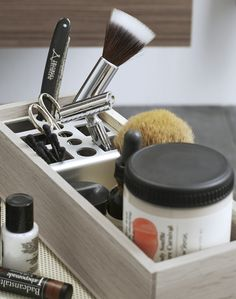 "Wooden tray with ingenious ""pencil holder""/divider, to keep tidy smaller items of toiletries and cosmetics."